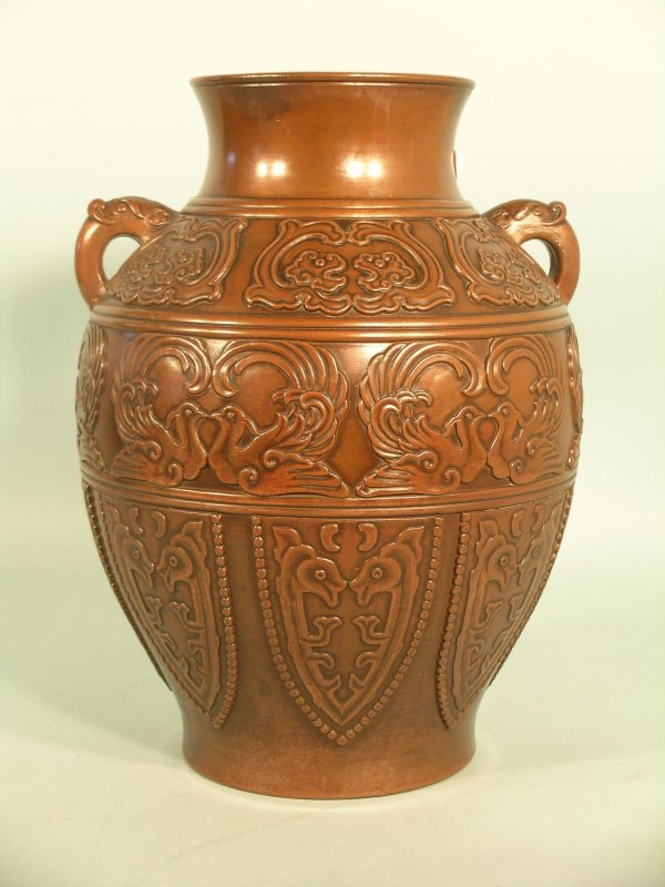 2: A Japanese earthenware copper clad vase, late 19th/e