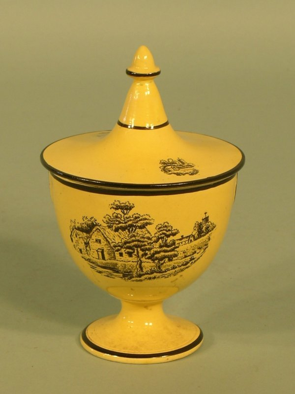 13: A yellow glazed pedestal cup and cover early 19th c