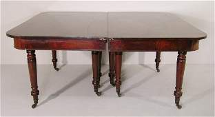 210: A Regency mahogany pull-out dining table with roun
