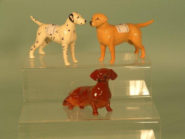 9B: Three Beswick dogs