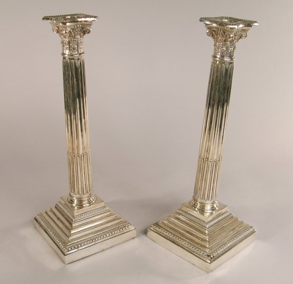6C: A pair of Walker & Hall A1 plate fluted candlestick