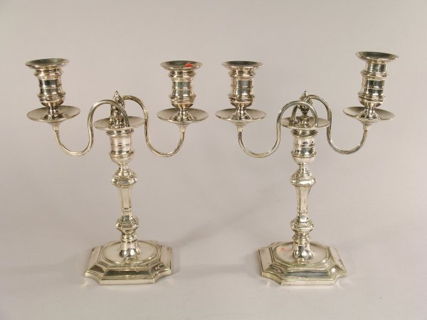 7C: A pair of Mappin & Webb two branch candelabrum