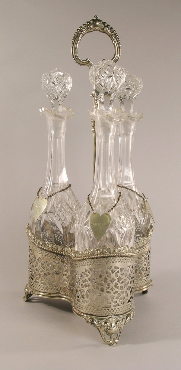 10C: A silver plated three bottle decanter stand