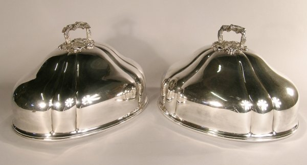 11C: A pair of ogee moulded plated dish covers