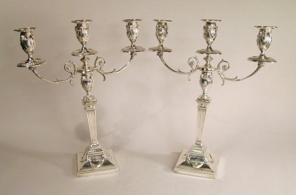 21C: A pair of silver candelabrum, Walker & Hall, Sheff