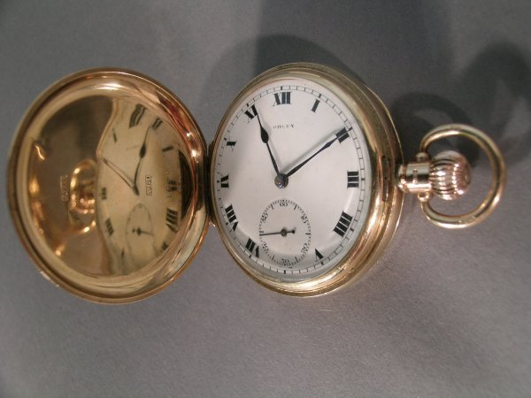 211C: A Rolex 9ct gold cased full hunter pocket watch,