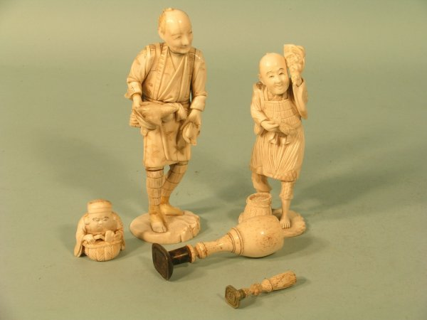15E: A Japanese sectional ivory figure of a fisherman,