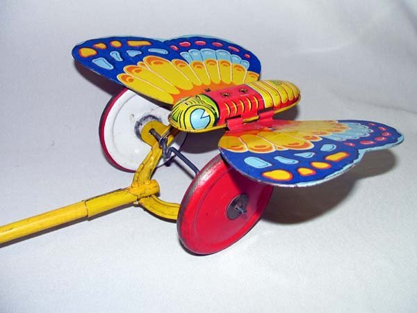 12: TIN TOY PUSH & PULL BUTTERFLY