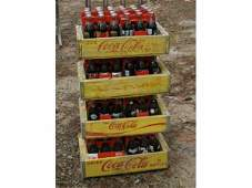 490 Four cases of CocaCola commemorative bottles in c