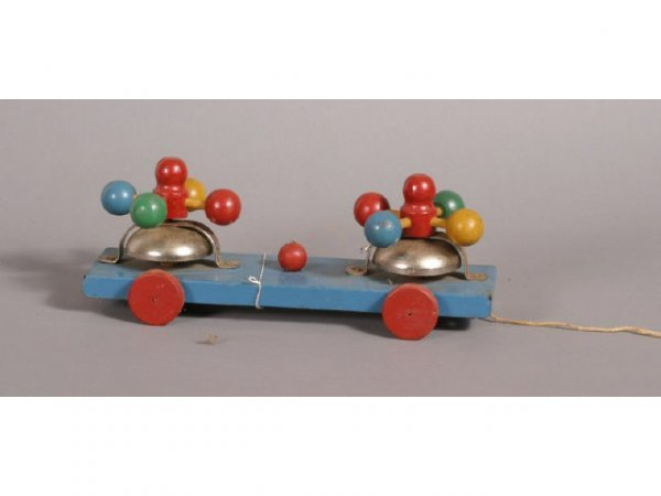3010: Tin and wood ringing bell pull toy