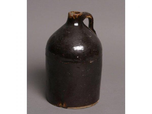 3: Brown stoneware jug; no markings; 9T