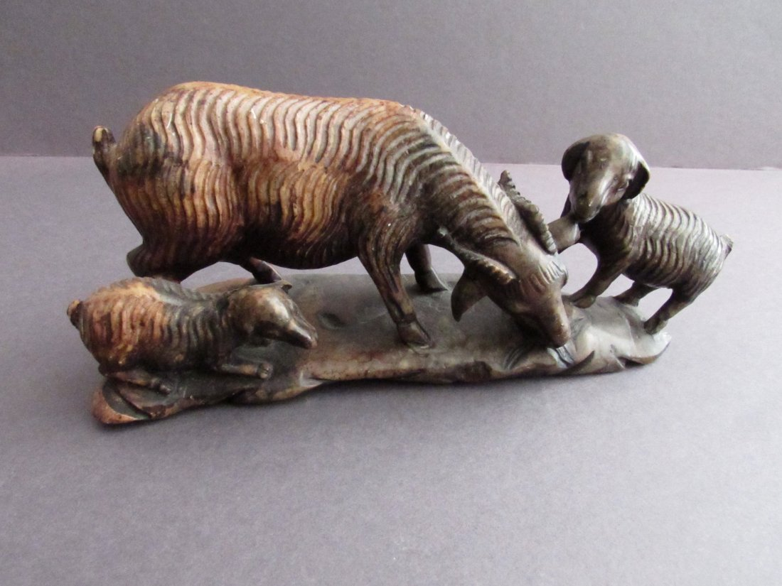 Chinese soapstone carving of three goats.