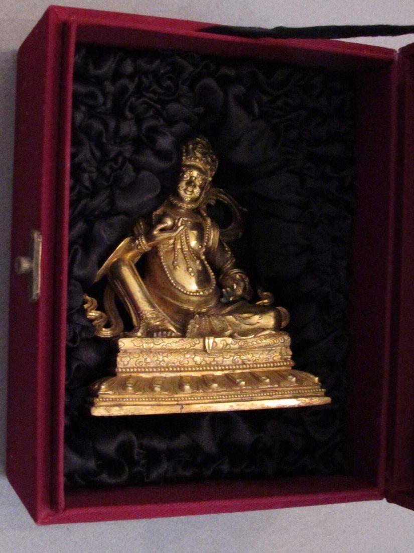 Very good Sino-Tibetan gilt bronze figure of Jambhala