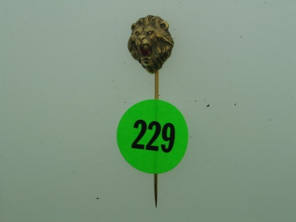 """229: Ladies antique stick pin approx 2"""" long.  Lions he"""