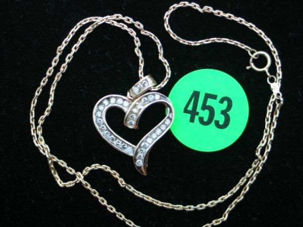453: Ladies 14kt yellow gold apprx 1cttw diamond heart