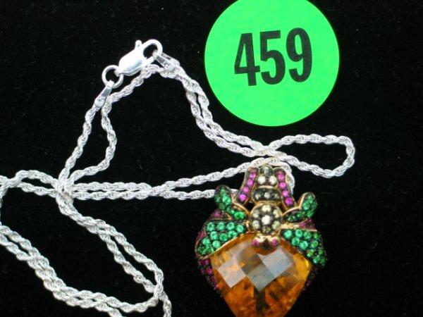 459: Ladies antique sterling silver pendant w/apprx 35c