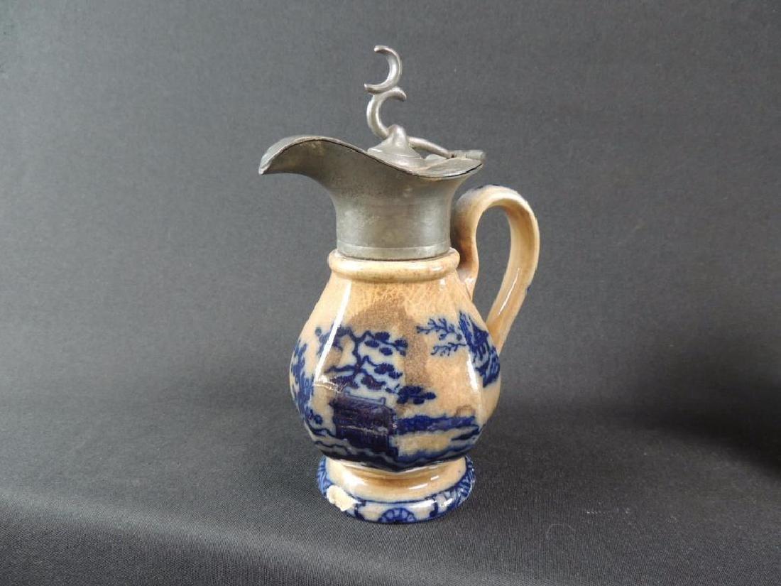 Antique Stoneware Syrup Featuring Oriental Design