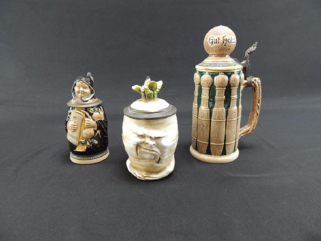 Group of three antique character steins