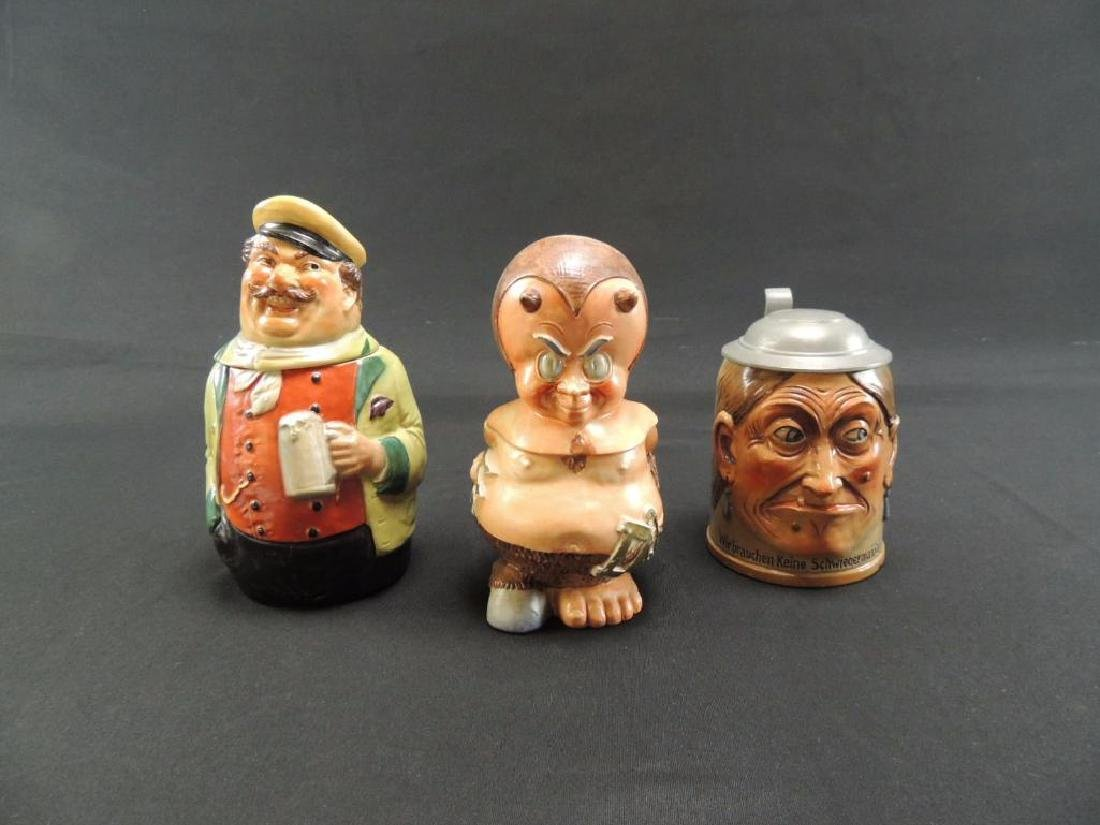 Group of three antique German character steins