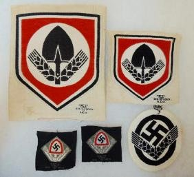 Group of 4 WW2 German RAD Cap and Shirt Insignia's