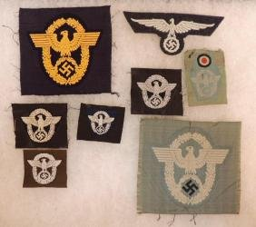 Group of 8 WW2 German Police Cap and Sleeve Eagle