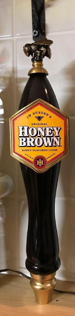 JW Dundee's honey brown advertising beer tapper