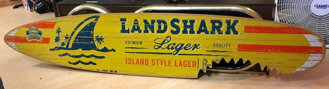 Land shark logger advertising wood surfboard sign