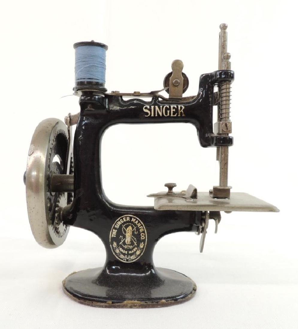 Small Singer Sewing Machine and Book