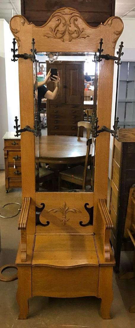 Antique oak hall tree with umbrella holder and ornate