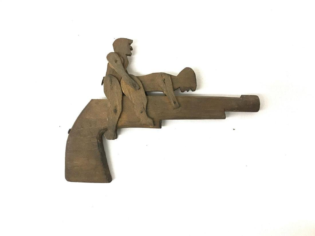 Folk art copulating gun