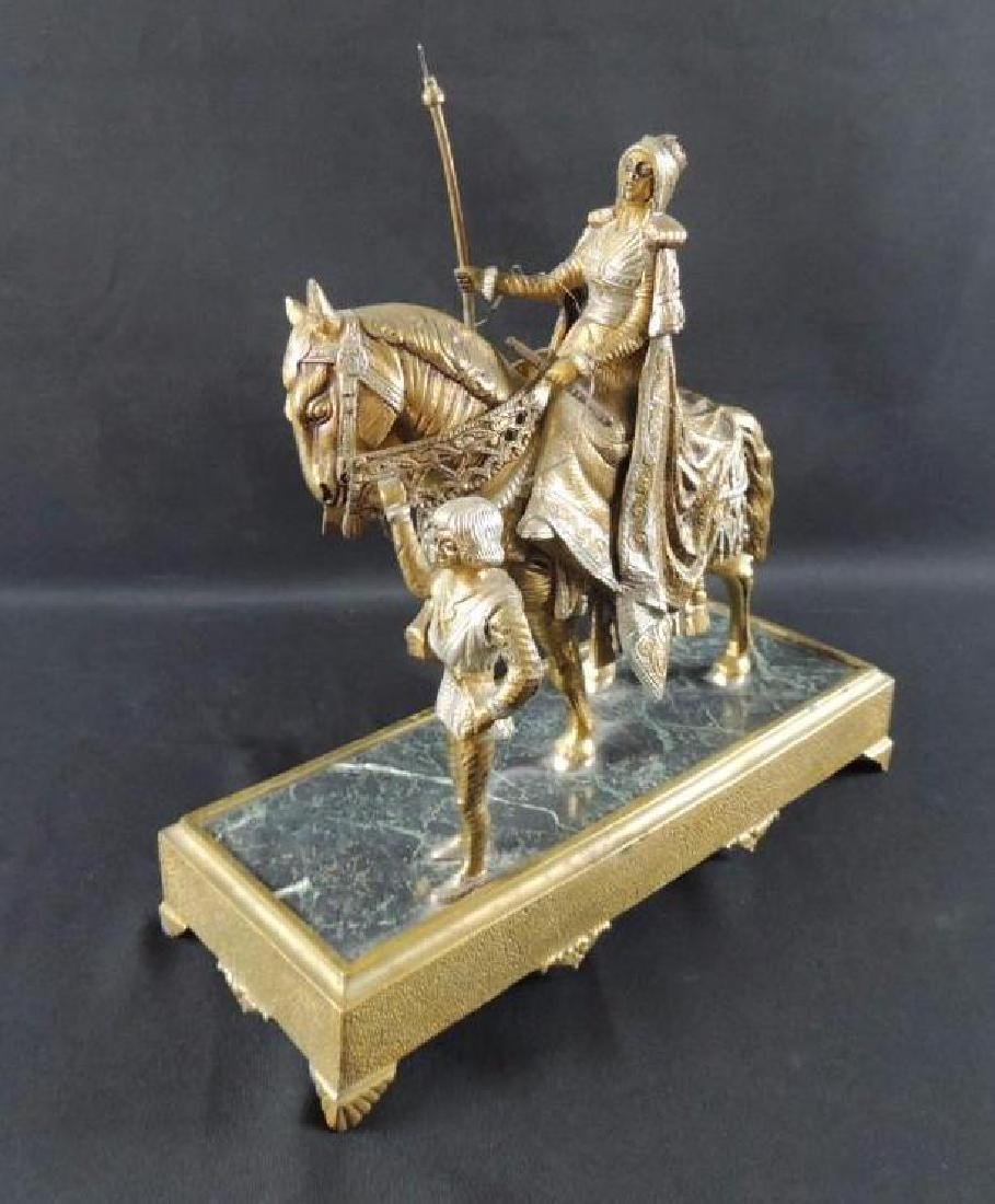 Antique Brass Statue Featuring Woman on Horse with Boy