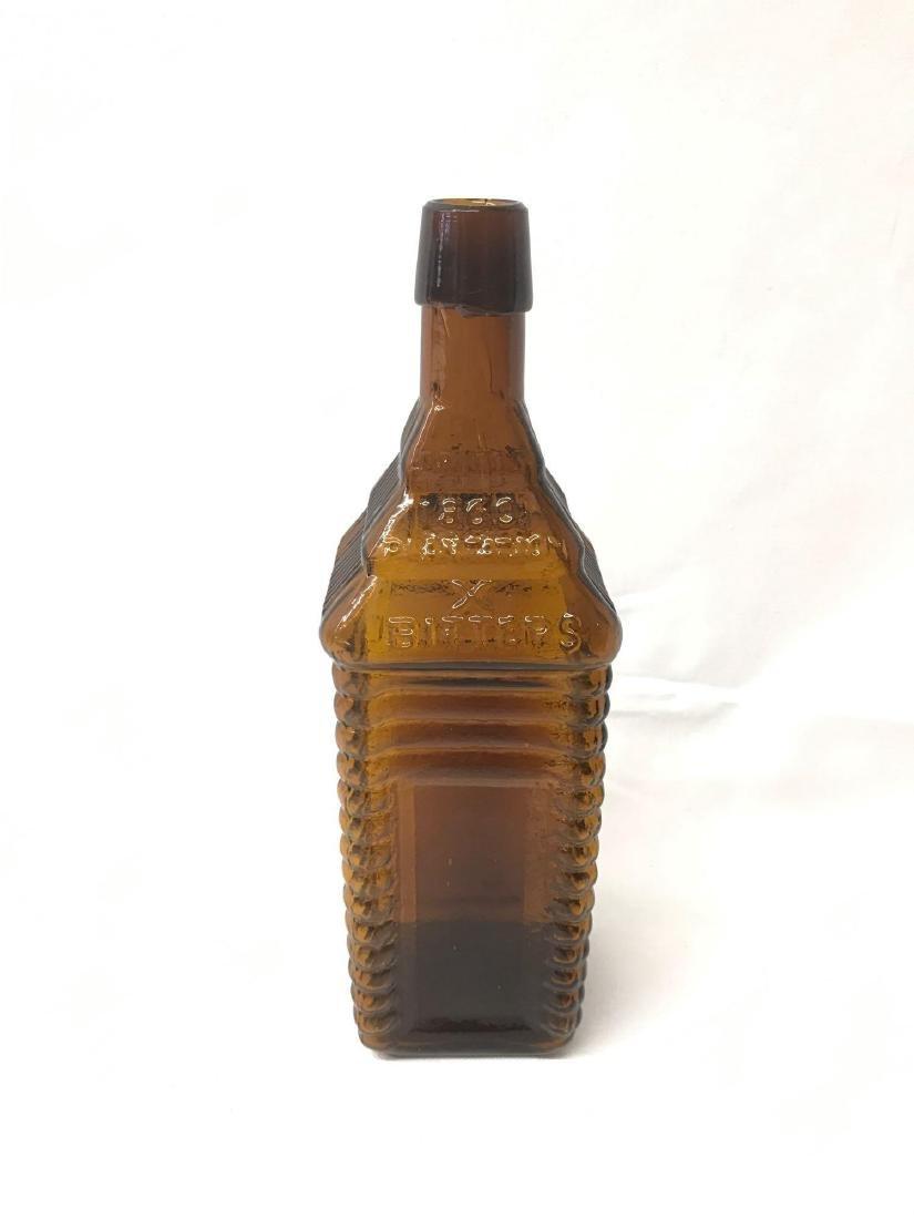 Antique 1860 plantation X bitters amber bottle