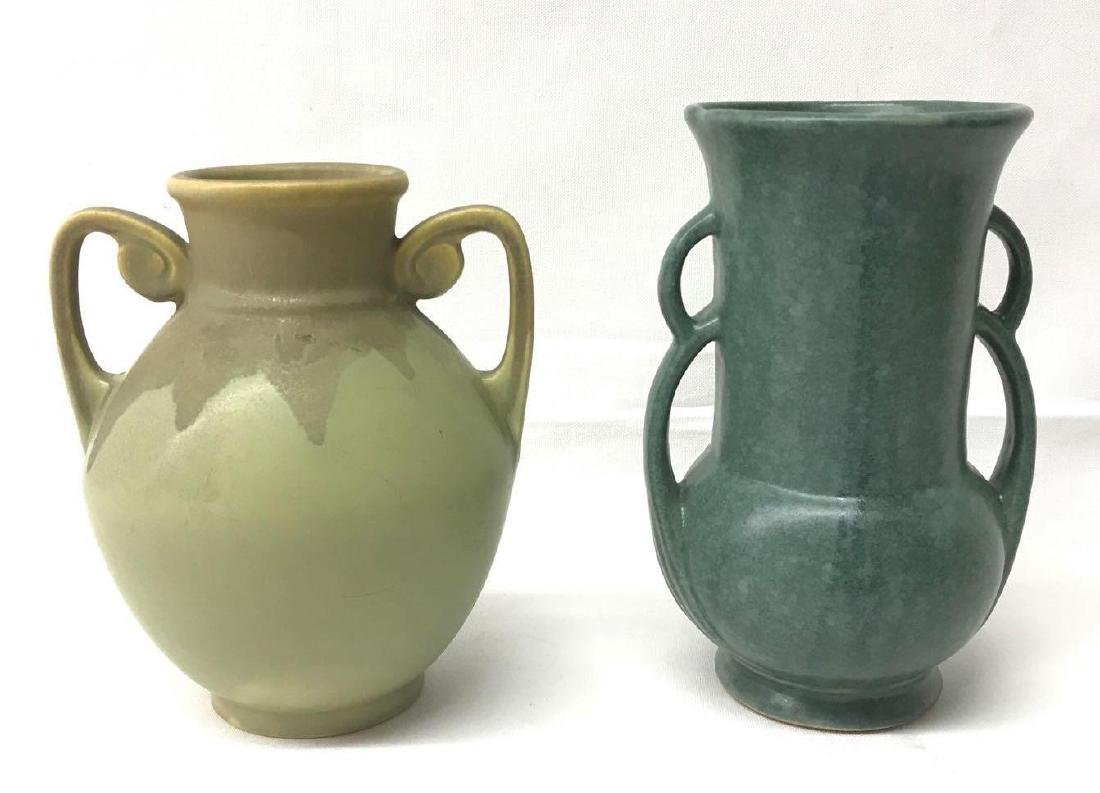 Group of two vases featuring Roseville