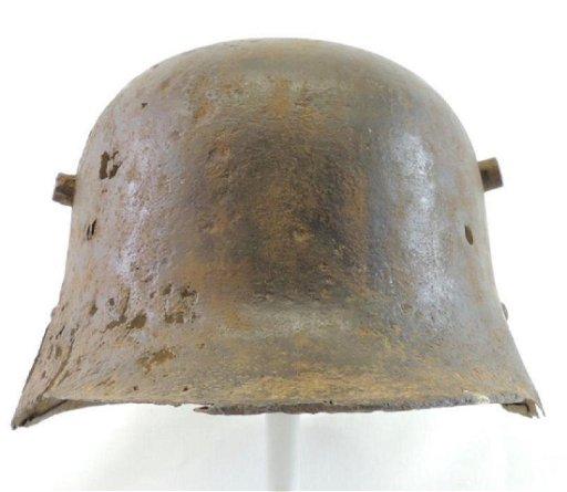 WW2 German Helmet with Original Battle Damage