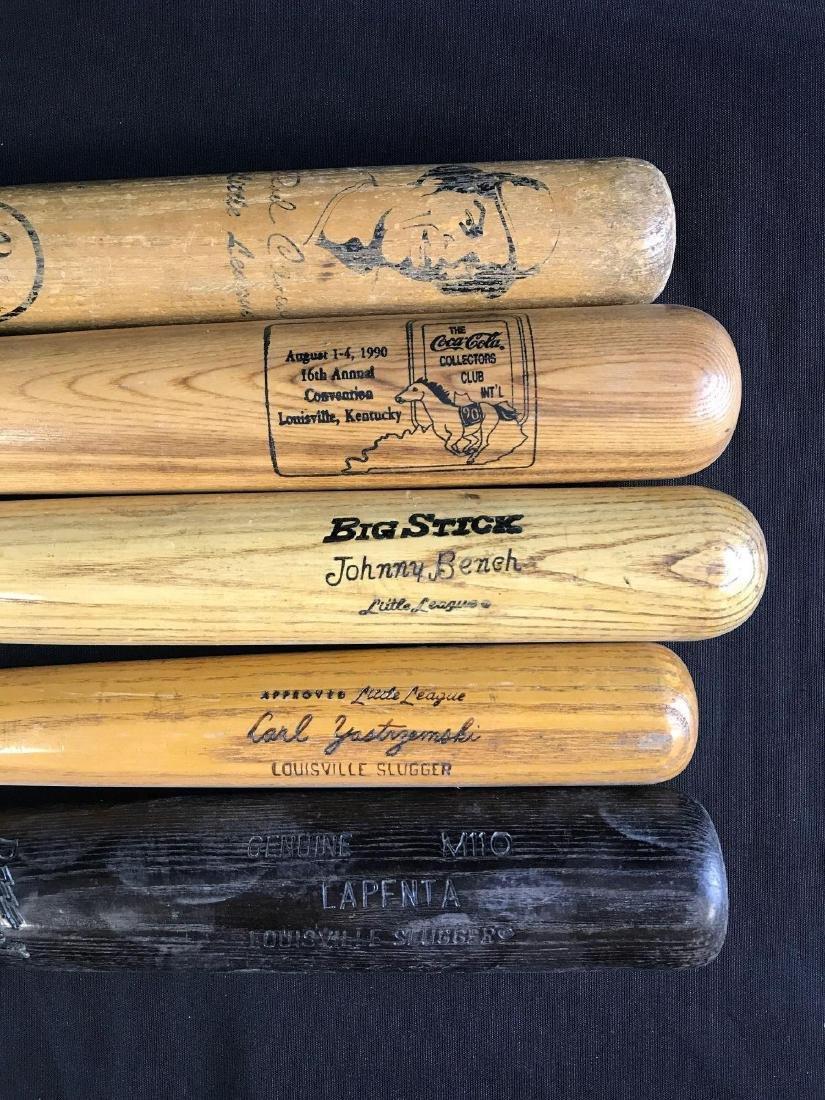 Group of five baseball bats featuring Louisville - 2
