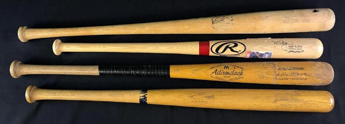 Group of four baseball bats featuring Willie Mays and