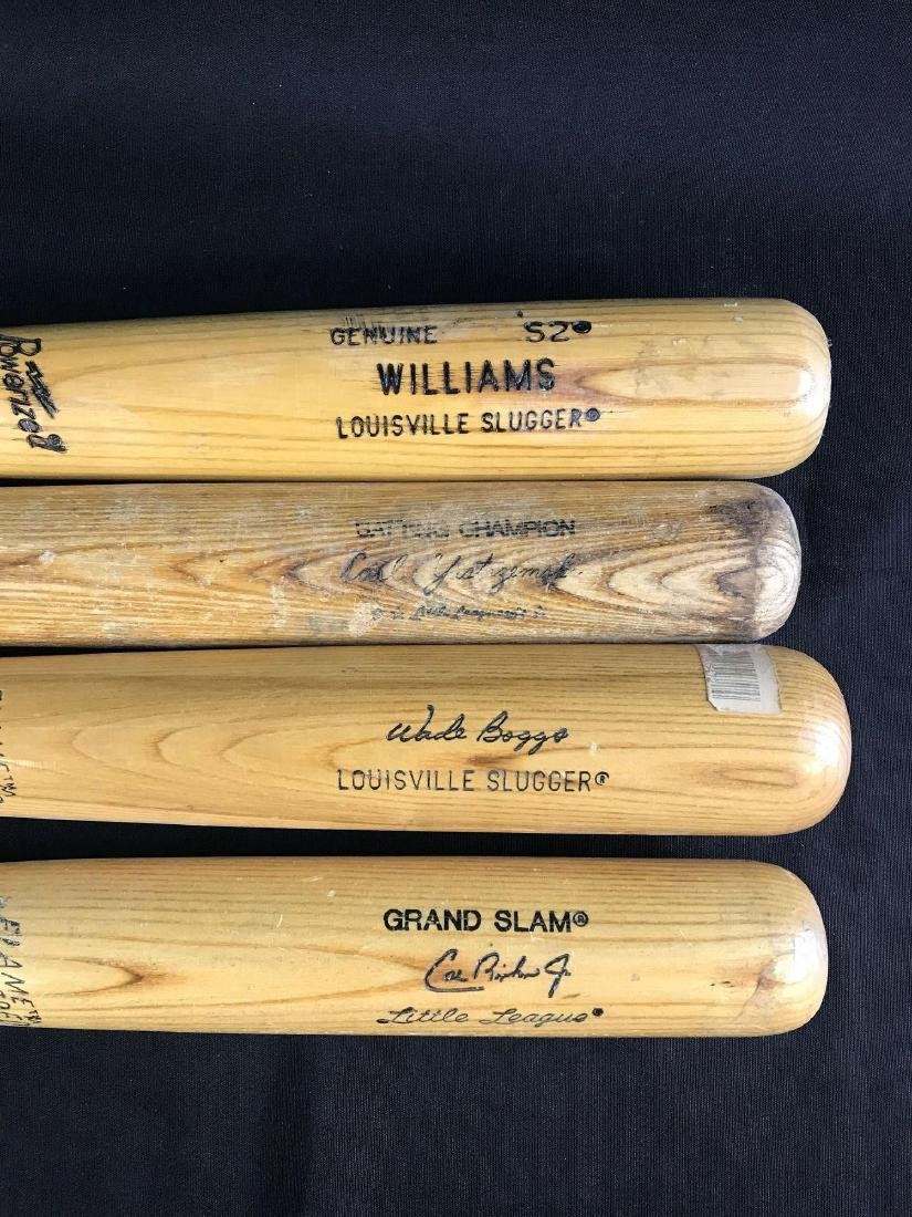 Group of four Louisville slugger baseball bats - 2