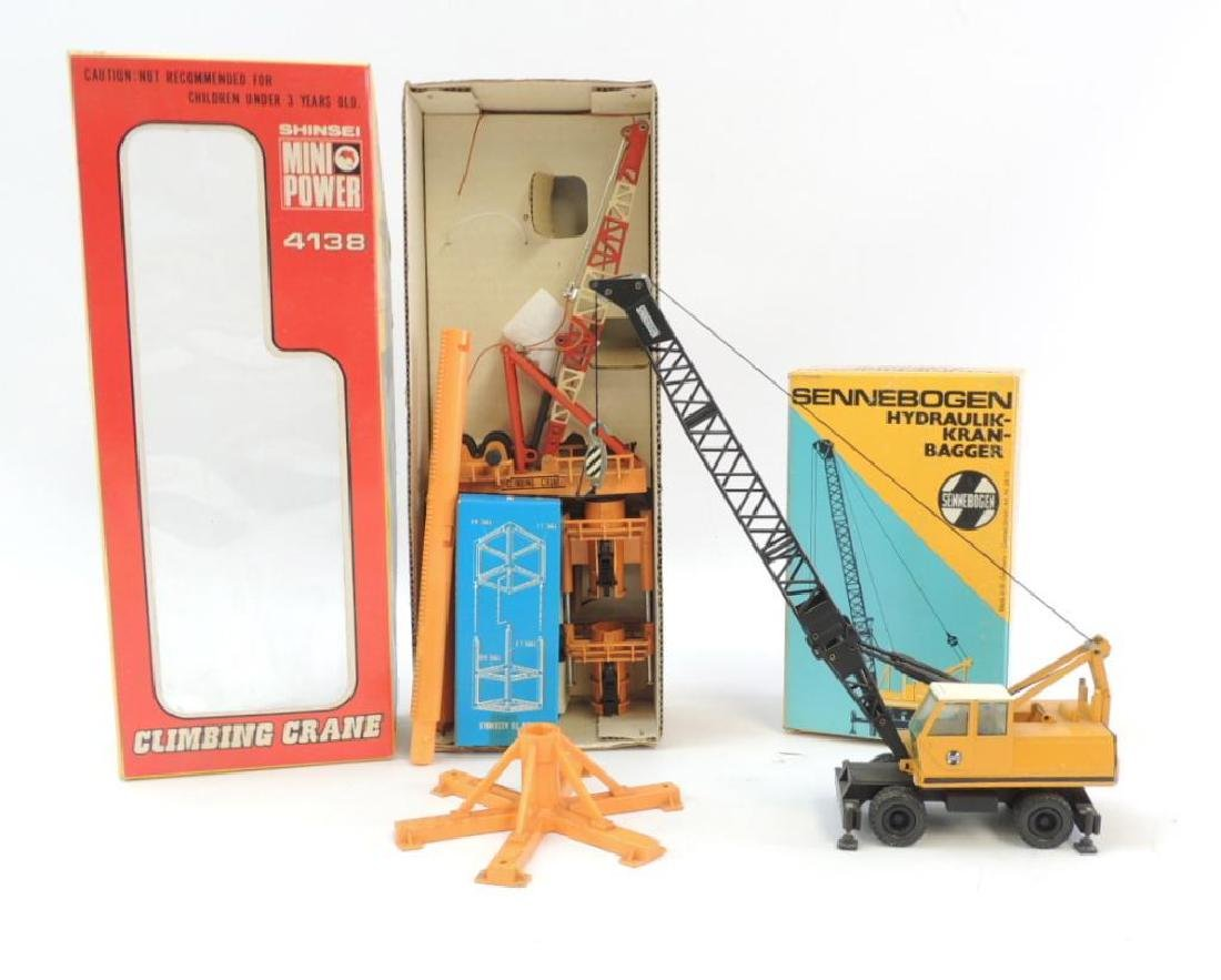 Group of 2 Die-Cast Toy Cranes Featuring Shinsei 4138