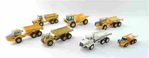 Group of 7 Die-Cast and Plastic Toy Dump Trucks