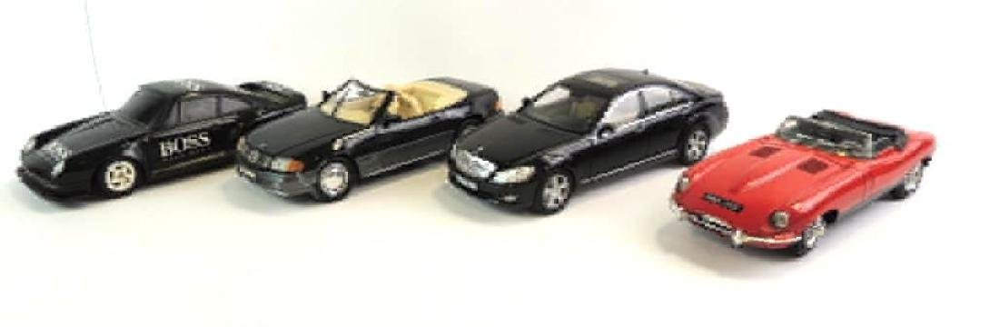 Group Of 4 Die-Cast Cars Featuring Mercedes-Benz