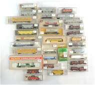 Group of 32 N Scale Train Cars with Original Cases
