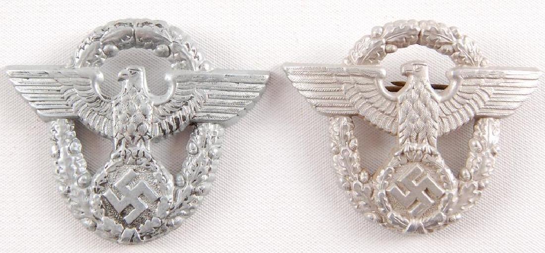 Group of 2 WW2 German Cap Eagle Badges