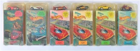 Group of 6 Hit Wheels Heroes on Hot Wheels VHS Packs