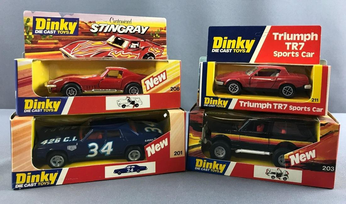 Group of 4 Dinky die cast toy vehicles in original