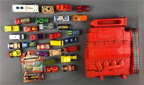 Group of Hot Wheels and Matchbox cars and carrying case