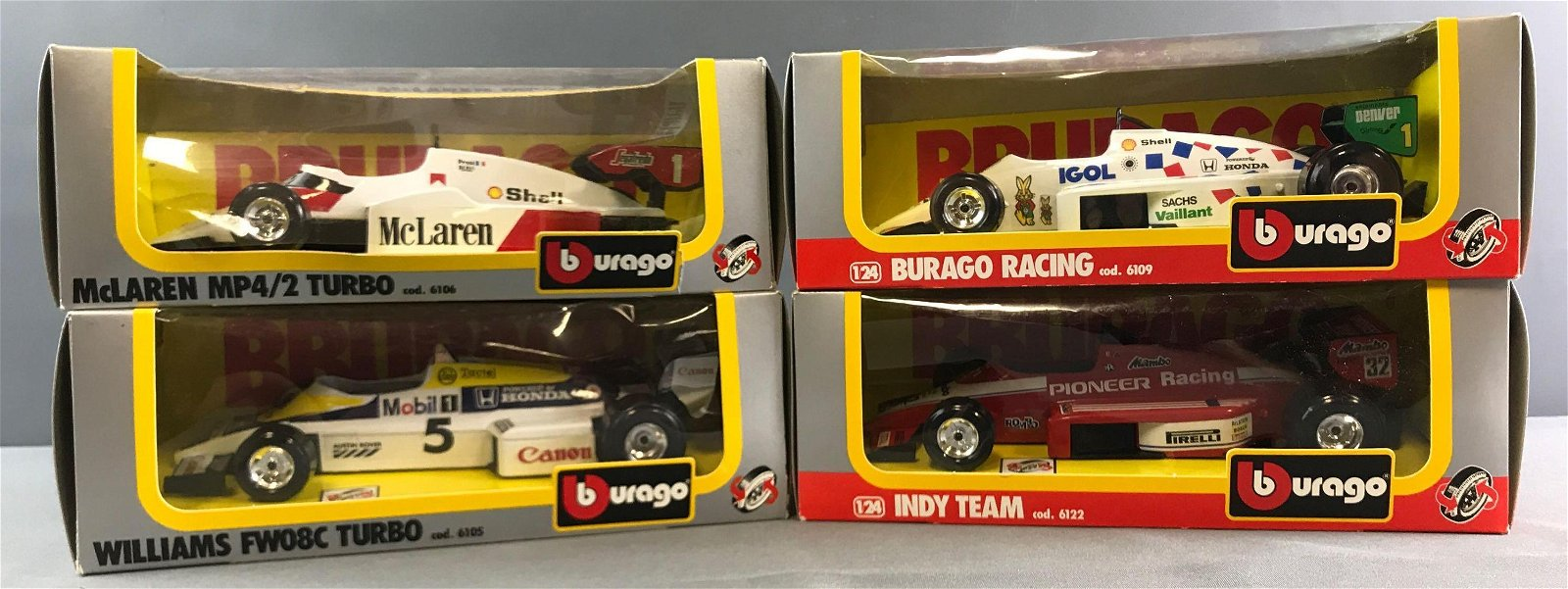 Group of 4 Burago Die Cast and Plastic Racing Cars In