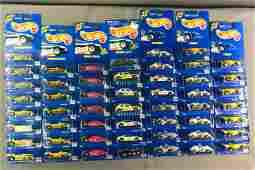 Group of 50+ Hot Wheels Vehicles In Original Packaging