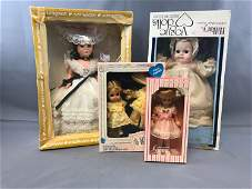 Group of four vintage dolls in original packaging