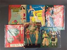 Group of six vintage paper doll sets