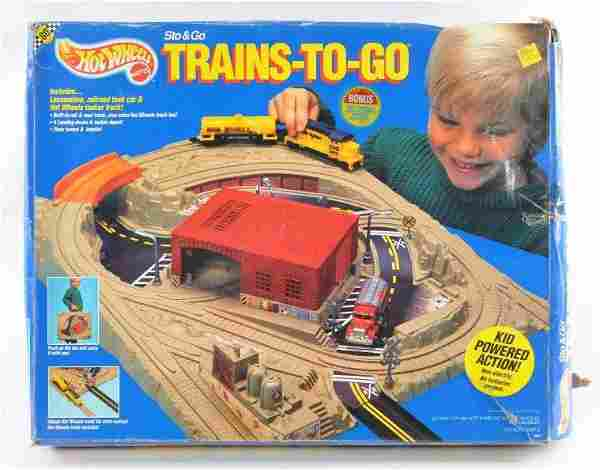 Hot Wheels Sto and Go Trains-To-Go Playset with